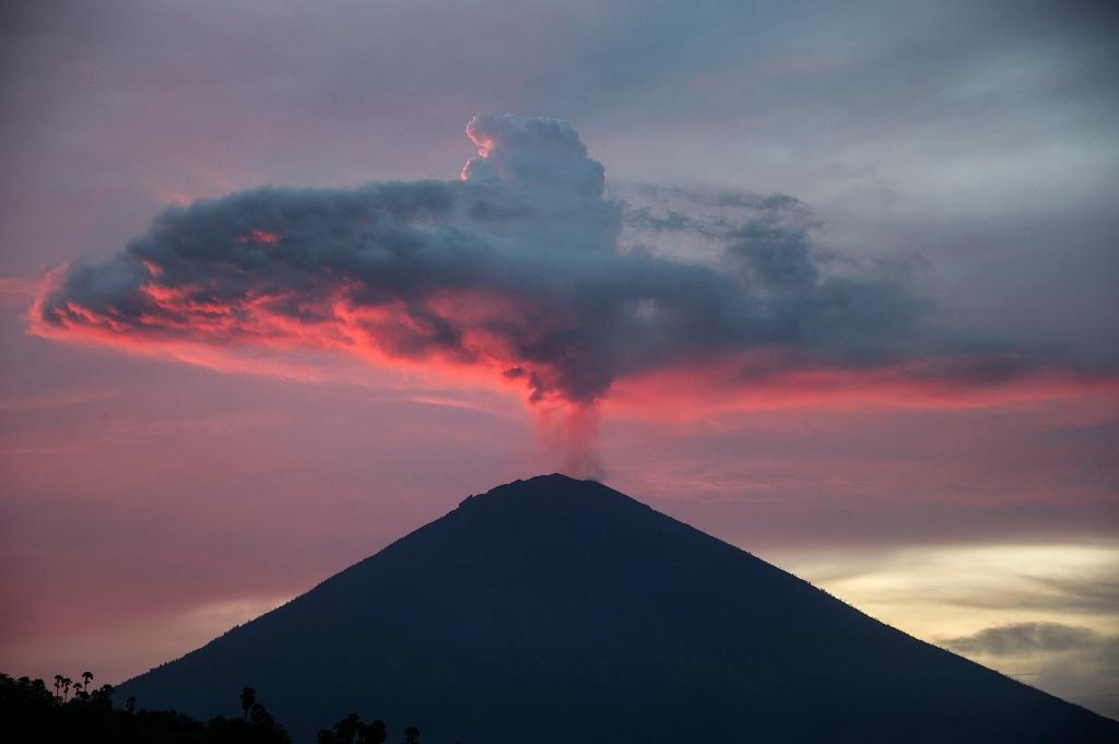 The threatened eruption of Mount Agung has burned a hole in Bali's economy, with wedding planners, dive shops and farmers all bearing the brunt (AFP Photo/JUNI KRISWANTO)