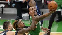 Celtics run past Magic 124-97 after week-long hiatus
