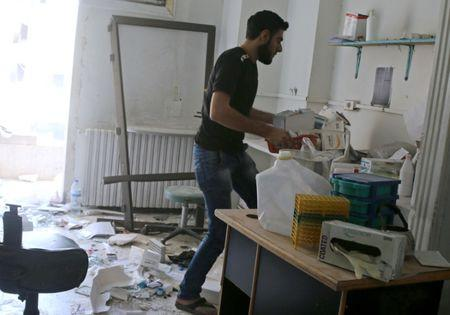 A man removes medicine inside the Medecins Sans Frontieres (MSF)-backed al-Quds hospital after it was hit by airstrikes, in a rebel-held area of Syria's Aleppo