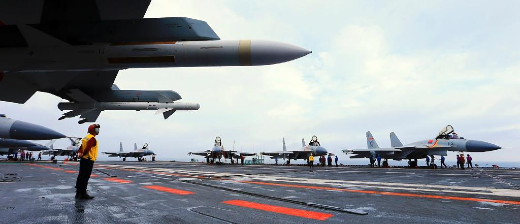 The drill included multiple take-offs by J-15 fighters from the deck of the Liaoning, Chinese state media said (AFP Photo/-)
