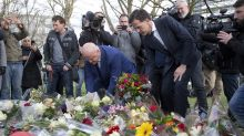 The Latest: Dutch PM leaves flowers for Utrecht victims