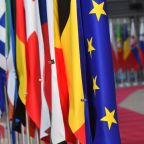 Battered EU centre holds off populist surge in vote