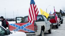 Confederate flag-bearing trucks park outside Michigan school