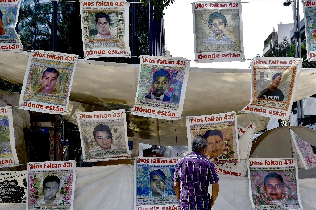 Independent investigators have issued a scathing report on the disappearance of 43 Mexican students, accusing the government of obstructing their probe (AFP Photo/Yuri Cortez)