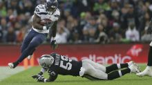 Seahawks roll behind Wilson's 3 TDs; Raiders QB Carr injured