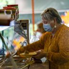 St. Louis and L.A. now require masks indoors. With cases rising, will other cities follow suit?