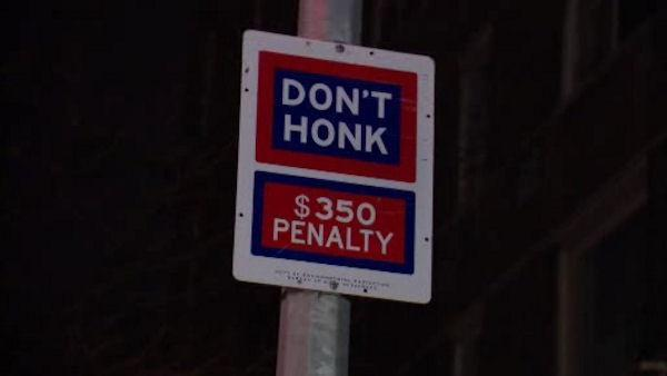 City taking down 'no honking' signs
