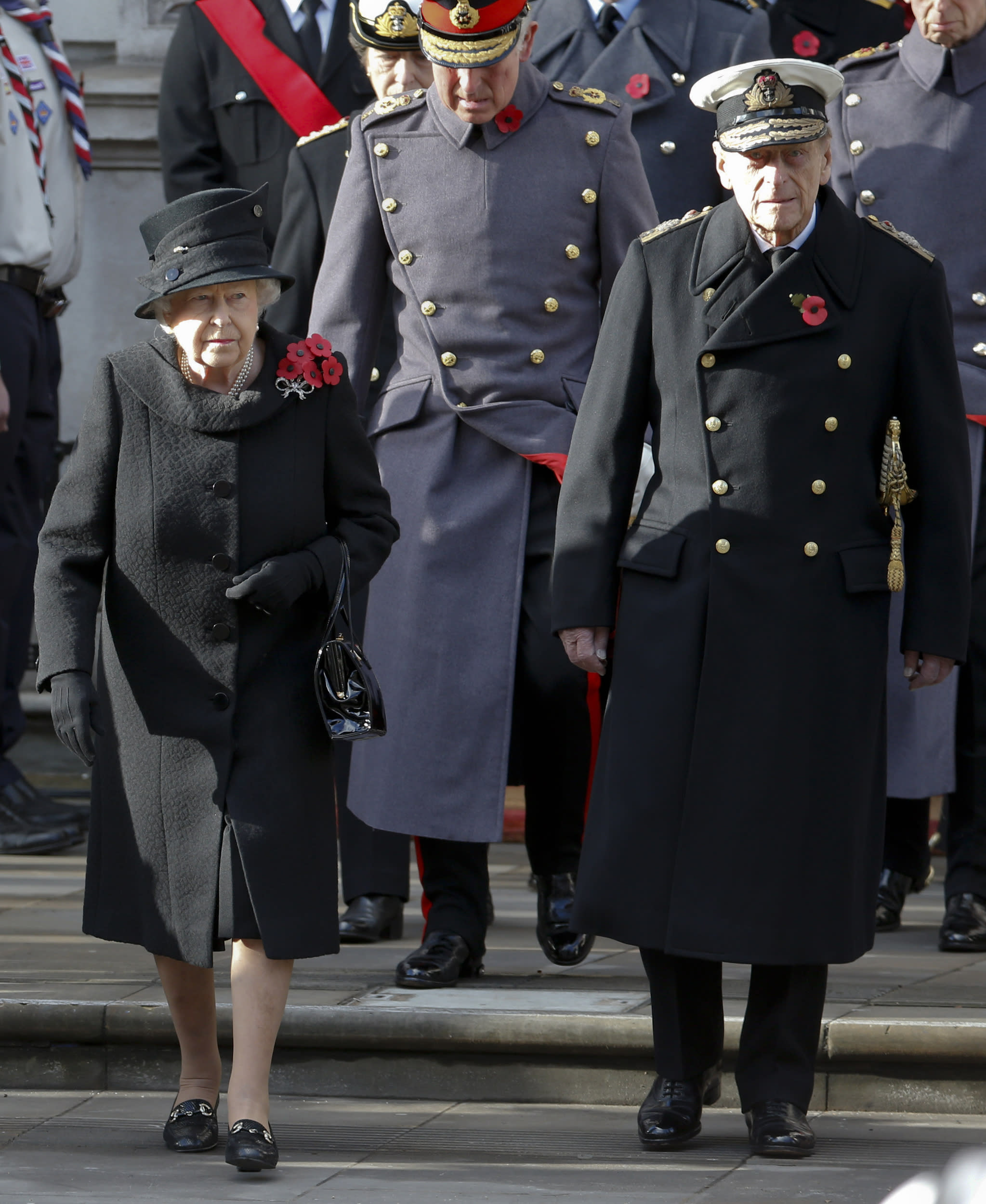 FILE - A Sunday, Nov. 13, 2016 file photo of Britain's Queen Elizabeth II and Prince Philip walking out to take part in the Remembrance Sunday service at the Cenotaph in London. Queen Elizabeth II will not personally place a wreath on The Cenotaph on Remembrance Sunday this year. The aging monarch and her husband Prince Philip will instead watch the ceremony from a balcony at the Foreign & Commonwealth Office. (AP Photo/Alastair Grant, File)