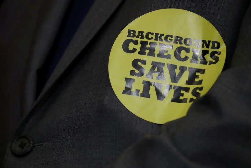 Spiking U.S. gun sales deluge FBI's background check system, cause delays