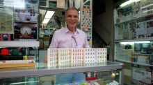 Artisan keeps his craft alive with each carved mahjong tile