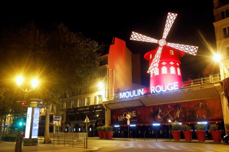 A view shows empty streets around the Moulin Rouge cabaret during the late-night curfew in Paris