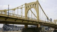 MLB umpire stops woman from jumping off Roberto Clemente Bridge