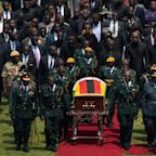 Empty seats give Robert Mugabe fitting farewell in stadium funeral