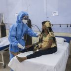 India reports record day of virus deaths as cases level off
