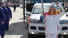 Evgeni Malkin's mom ran the Olympic torch and it was adorable