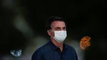 Brazil's Bolsonaro, infected with COVID-19, touts unproven drug