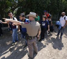Judge blocks Texas troopers from stopping migrant transports