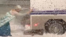 Drag Queen Elsa frees police truck trapped in Boston blizzard