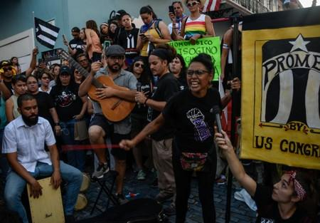Members of theatre group Papel Machete perform during a protest calling for the resignation of Governor Ricardo Rossello in front of La Fortaleza in San Juan, Puerto Rico