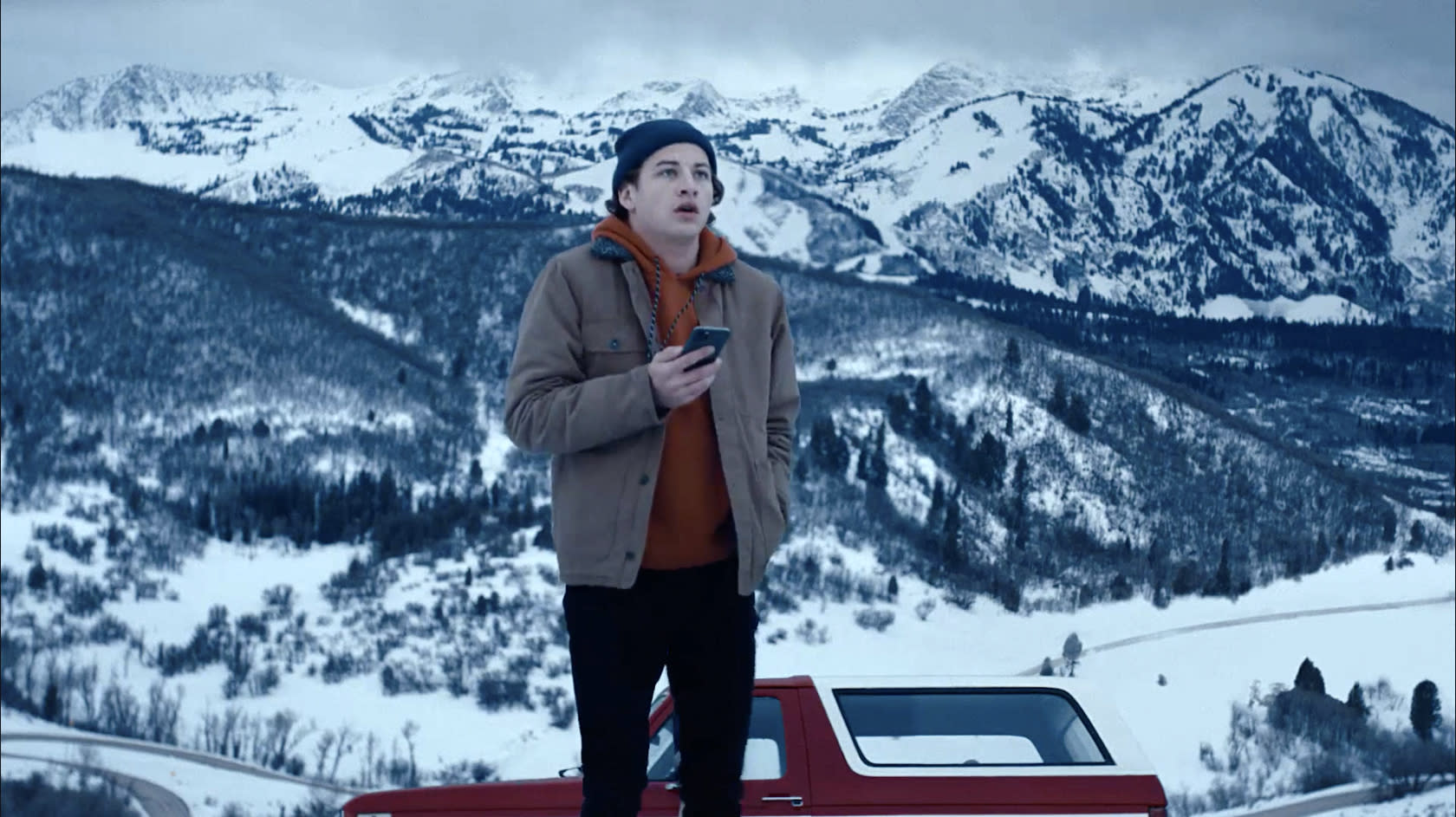 """This image released by Quibi shows Tye Sheridan in a scene from """"Wireless"""" which follows a college student navigating the snowy Colorado mountains. (Quibi via AP)"""