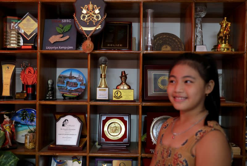 Licypriya Kangujam poses in front of her trophies at her house in Noida