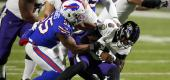 Buffalo Bills defender Jerry Hughes sacks Ravens quarterback Lamar Jackson. (AP)