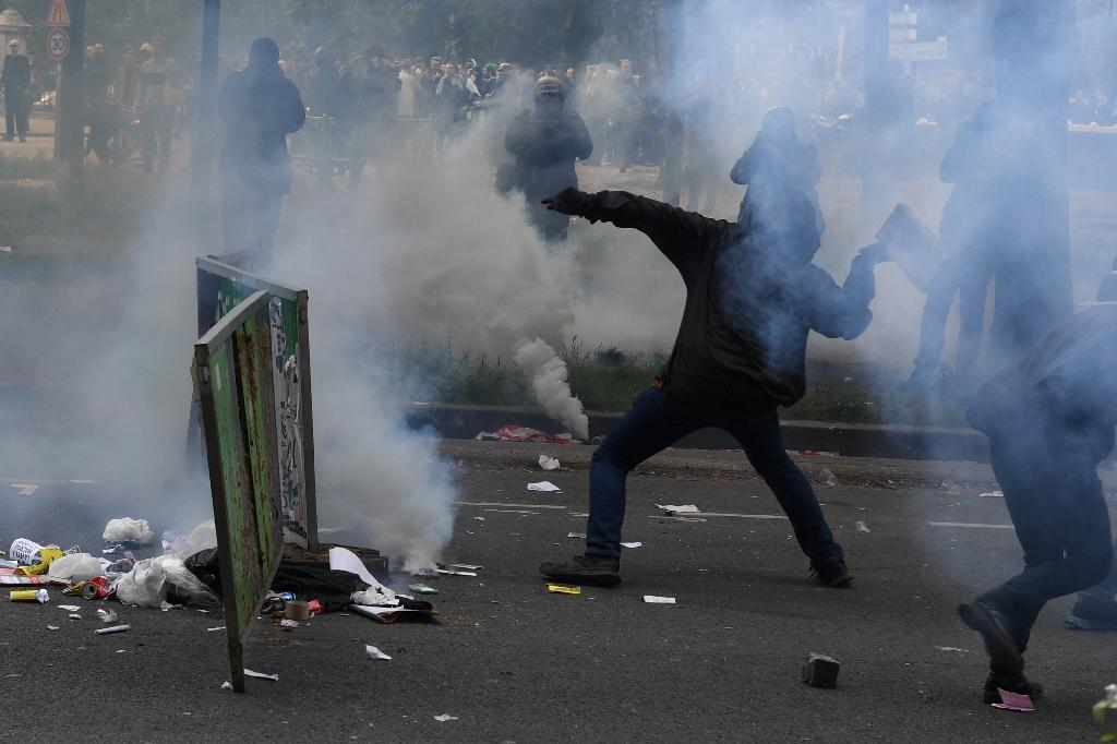 French anti-capitalist protesters clashed with police in Paris on Tuesday on the sidelines of a march for the annual May Day workers' rally (AFP Photo/Alain JOCARD)