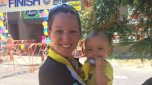 This photo of a mom breastfeeding after finishing a triathlon is going viral