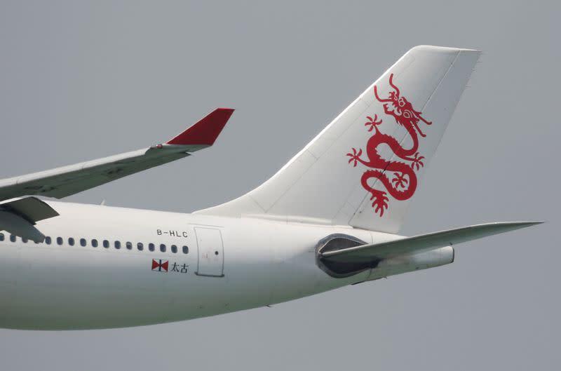 FILE PHOTO: A Cathay Dragon Airbus A330 descends before landing at Hong Kong Airport in Hong Kong