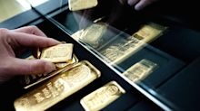 Gold climbs as dollar dives, crosses key chart milestone