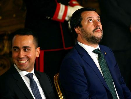 FILE PHOTO: Interior Minister Matteo Salvini looks on next to Italy's Minister of Labour and Industry Luigi Di Maio at the Quirinal palace in Rome, Italy, June 1, 2018. REUTERS/Tony Gentile/File Photo