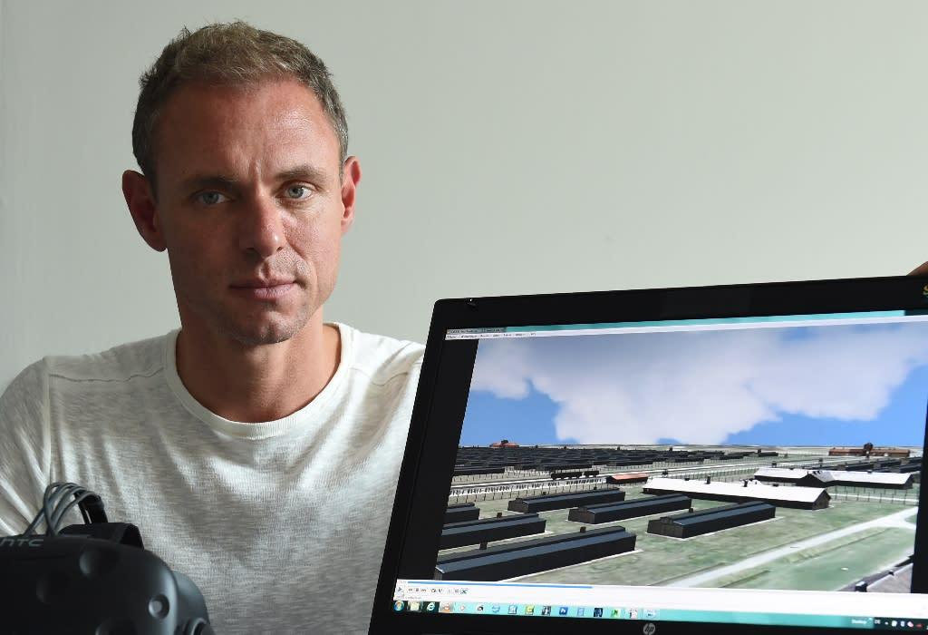 Bavarian state crime office (LKA) digital imaging expert Ralf Breker presents a 3D model of the former Nazi concentration camp Auschwitz (AFP Photo/Christof Stache)