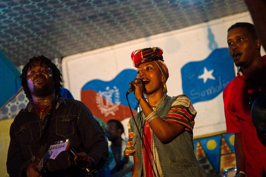 Sudanese singer Alsarah performs with Kenyan band Afro-Simba at the International Solidarity Concert as part of the Mogadishu Music Festival, in 2013 (AFP Photo/PHIL MOORE)