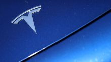 Tesla woos retail investors with stock split, shares rise
