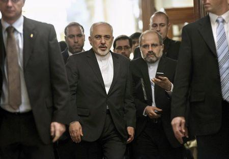 Iranian Foreign Minister Javad Zarif (C) leaves a meeting with U.S. Secretary of State John Kerry and other U.S. officials at the Beau Rivage Palace Hotel March 26, 2015 in Lausanne, Switzerland. REUTERS/Brendan Smialowski/Pool