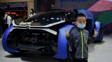 Crowds in face masks pack out China auto show after virus delay