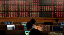 Global Markets: Asian stocks fall on concerns about fresh lockdowns, banking sector