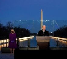 Inauguration Day 2021: Biden and Harris lead Lincoln Memorial vigil for Covid victims - follow live