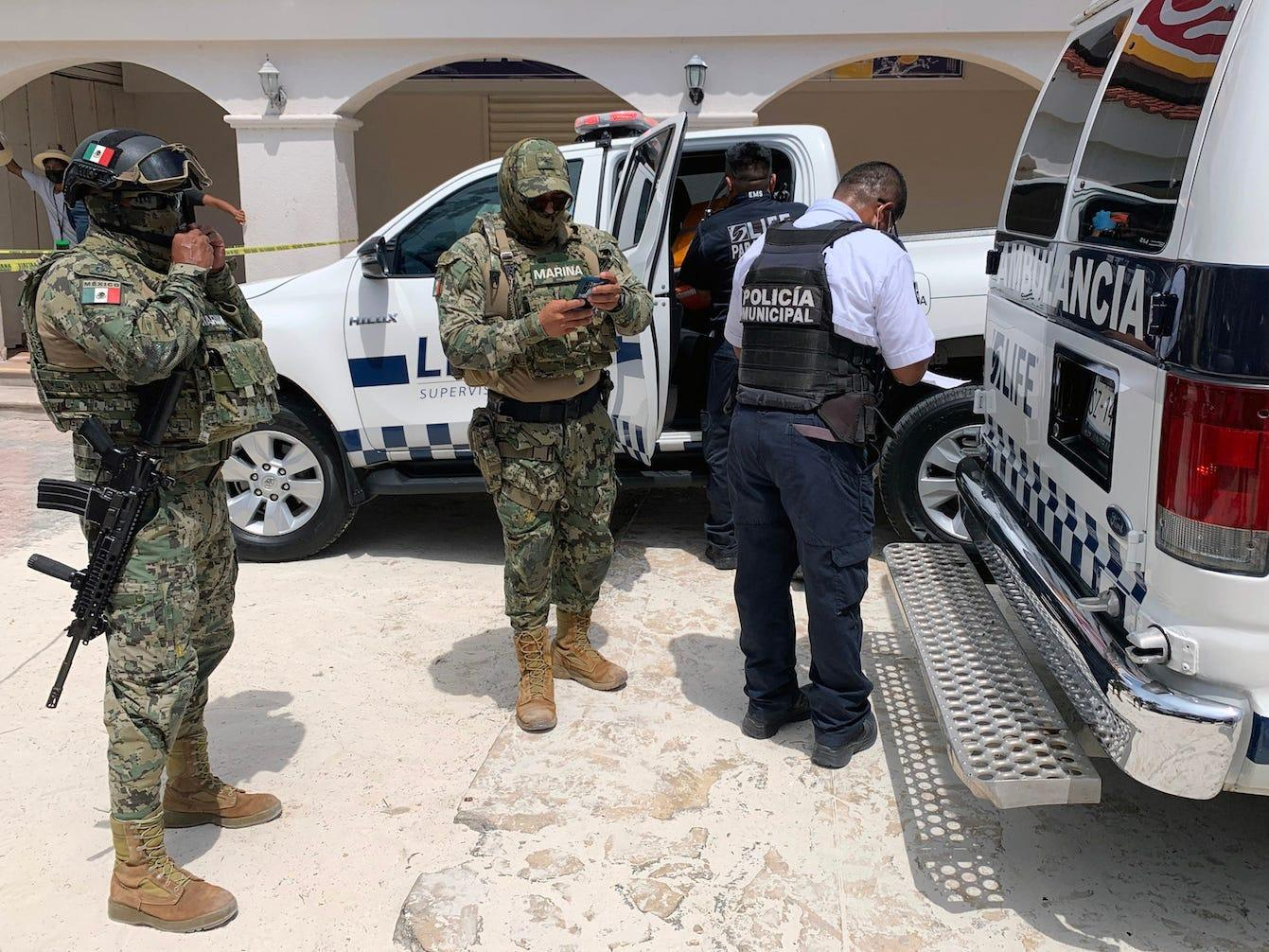 A US tourist in Cancun was wounded by a stray bullet when gunmen on jet skis reportedly killed 2 men at the beach