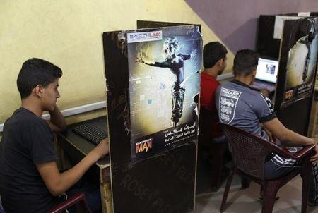 Iraqi Shi'ite youths use computers at an internet cafe in Sadr City in Baghdad