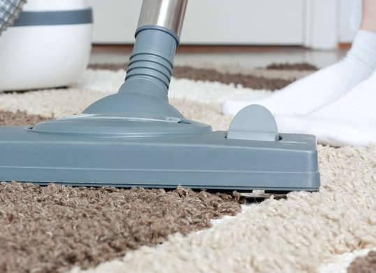 """<p>It's obvious that vacuuming keeps your carpets clean, but this common chore is also the key to ensuring they stay looking like new. Dirt has abrasive qualities, and when it's repeatedly ground into the carpet by everyday foot traffic, it can actually erode the backing over time. Vacuuming once a week (twice a week in busy areas) can remove up to 75 percent of the <a href=""""http://www.bobvila.com/slideshow/15-remarkably-easy-ways-to-create-a-dust-free-home-47177"""" rel=""""nofollow noopener"""" target=""""_blank"""" data-ylk=""""slk:dirt and debris"""" class=""""link rapid-noclick-resp"""">dirt and debris</a> and prevent your carpet from aging before its time. <i>Photo: fotosearch.com</i><b><br>RELATED: <a href=""""http://www.bobvila.com/slideshow/10-cleaning-habits-to-blame-for-your-messy-home-49360"""" rel=""""nofollow noopener"""" target=""""_blank"""" data-ylk=""""slk:10 Cleaning Habits to Blame for Your Messy Home"""" class=""""link rapid-noclick-resp"""">10 Cleaning Habits to Blame for Your Messy Home</a></b></p>"""