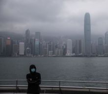 Hong Kong, U.S. take steps to curb coronavirus spread