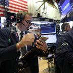 Stocks close slightly lower