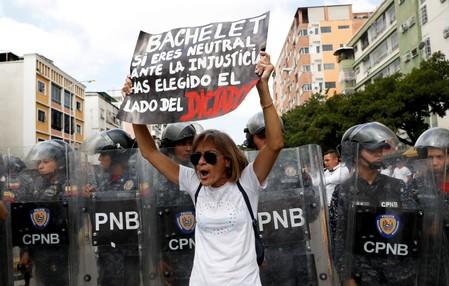 FILE PHOTO: Opposition supporters take part in a rally against Venezuelan President Nicolas Maduro's government in Caracas