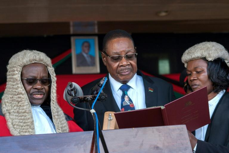 May 28 2019: Peter Mutharika, centre, is sworn in for his second term by Chief Justice Andrew Nyirenda, left. Months later, Nyirenda headed the the Supreme Court when it overturned the election result