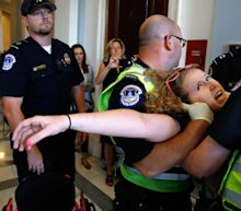 'Die-in' protesters dragged away from McConnell's office