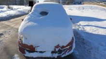 Motorist caught driving with 'porthole' in snow-covered windscreen charged