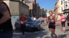 Woman wreaks havoc by driving onto course in middle of half-marathon in Plymouth