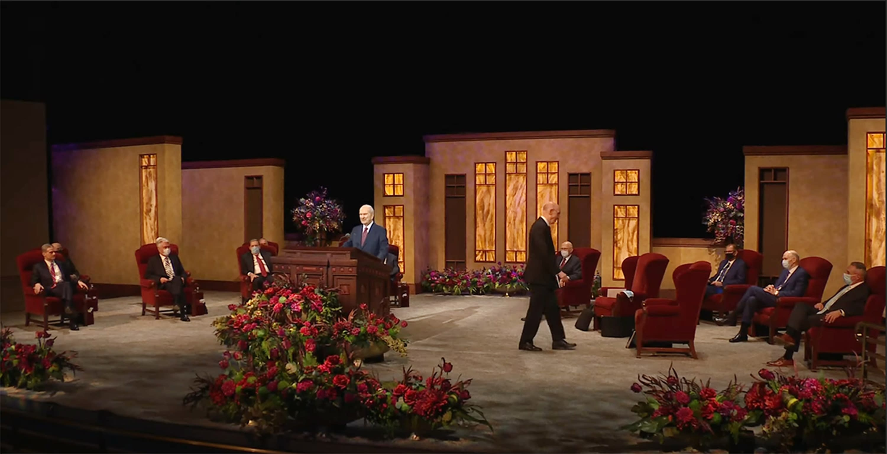 This Saturday, Oct. 3, 2020, video image streamed by The Salt Lake Temple of The Church of Jesus Christ of Latter-day Saints, shows church President Russell M. Nelson, at podium, with top leaders during the opening of the 190th Semiannual General Conference at the Conference Center Theater on Temple Square in Salt Lake City. The twice-annual conference kicked off Saturday without anyone attending in person and top leaders sitting some 6-feet apart inside an empty room as the faith takes precautions to avoid the spread of the coronavirus. (The Church of Jesus Christ of Latter-day Saints via AP)