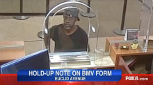 Bank robber left his name and address on note demanding cash, says FBI
